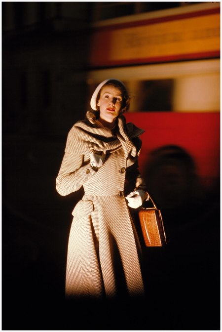 Wenda-parkinson-wearing-a-hardy-amies-coat-a-london-bus-can-be-seen-in-the-background-vogue-june-1949-norman-parkinson-archive